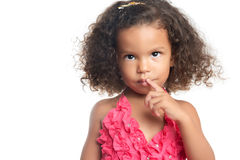 Portrait of a little girl with an afro hairstyle. Isolated on white Stock Image