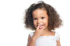 Portrait of a little girl with an afro hairstyle wearing a white dress Stock Photo