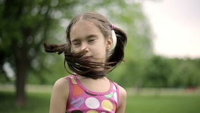 Portrait little girl is angry and disagrees crying in a summer park. Slow motion.  stock video footage