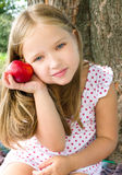 Portrait of a little girl with apple. Summer portrait of a little girl with red apple Stock Photos