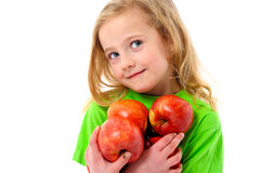 Portrait of little girl with apples Royalty Free Stock Image