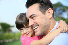 Portrait of little girl in the arms of her father Stock Photo
