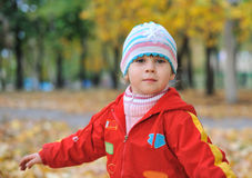 Portrait of the little girl in autumn forest Royalty Free Stock Photography
