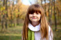 Portrait of little girl in the autumn forest Stock Images
