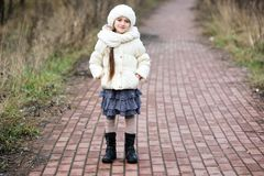 Portrait of little girl in autumn outfit Stock Photography