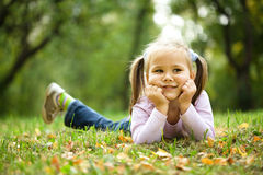 Portrait of a little girl in autumn park Royalty Free Stock Photography