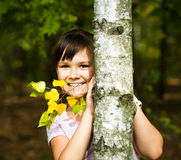 Portrait of a little girl in autumn park Stock Image