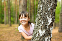Portrait of a little girl in autumn park Royalty Free Stock Images