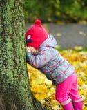 Portrait of a little girl in autumn park Stock Photo