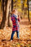 Portrait of little girl in autumn park Stock Photo