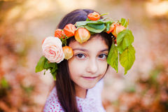 Portrait of little girl in autumn park Stock Photos