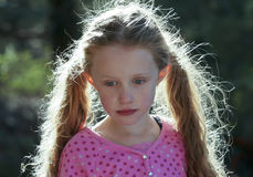 A Portrait of a Little Girl with Backlit Hair Royalty Free Stock Photos