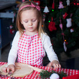 Portrait of little girl baking gingerbread cookies Stock Image