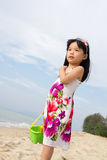 Portrait of little girl on beach. Portrait of happy little girl holding a bucket and spade on beach Stock Photos