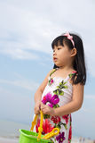 Portrait of little girl on beach. Holding a bucket and spade Royalty Free Stock Photography