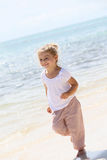 Portrait of a little girl on the beach enjoying Royalty Free Stock Photos