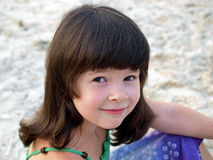 Portrait of a little girl on the beach. With soft focus on background stock photography