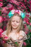 Portrait of little girl in beautiful blooming apple garden outdoors Royalty Free Stock Image