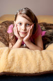 Portrait of a little girl in bed Royalty Free Stock Photo
