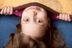 Portrait of a little girl in bed Royalty Free Stock Photos