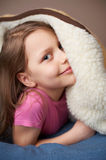 Portrait of a little girl in bed Royalty Free Stock Images