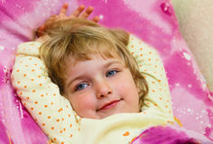 Portrait of the little girl. Portrait of the girl in a bed Stock Images