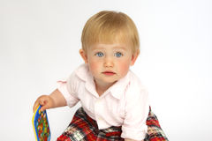Portrait of a little girl blonde with blue eyes. Portrait of a pretty happy girls baby blonde ,looking to the side , close up Stock Photos