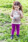 Portrait of little girl blow bubbles Stock Photography