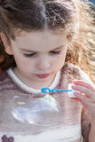 Portrait of little girl blow bubbles Royalty Free Stock Image