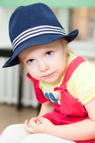 Portrait of little girl in blue hat stock photography