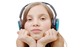 Portrait of  little girl with blue headphone, on white Royalty Free Stock Images