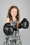 Portrait of little girl in boxing gloves Stock Photos