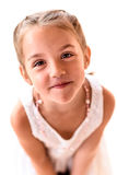 Portrait of a little girl with braids screaming. Stock Photography