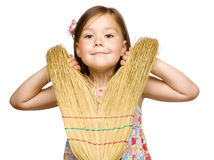 Portrait of a little girl with broom Royalty Free Stock Image