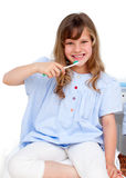Portrait of a little girl brushing her teeth Stock Image