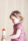 Portrait of a little girl building toy tower Royalty Free Stock Photo