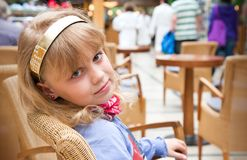 Portrait of a little girl in cafe Royalty Free Stock Image