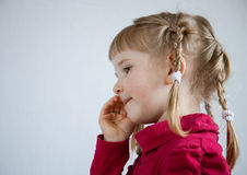 Portrait of a little girl calling somebody Stock Image