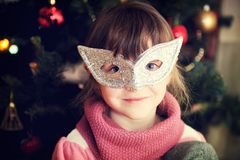 Portrait of little girl in carnival mask Royalty Free Stock Photography