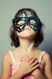 Portrait of little girl in carnival mask Royalty Free Stock Image