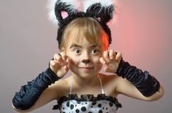 Portrait of a little girl with cat make-up on a gray background. Royalty Free Stock Images