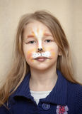 Portrait of little girl with cat painting makeup Royalty Free Stock Image