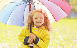 Portrait of little girl child with colorful umbrella Stock Image
