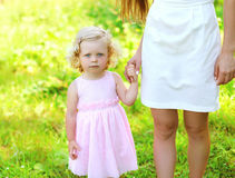 Portrait of little girl child, daughter holds hand royalty free stock photo