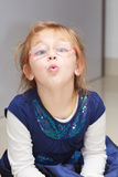 Portrait little girl child making funny face doing fun Stock Photo