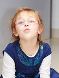 Portrait little girl child making funny face doing fun Royalty Free Stock Photo