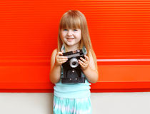 Portrait of little girl child with old retro vintage camera Royalty Free Stock Image