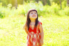 Portrait of little girl child outdoors enjoying Stock Photography