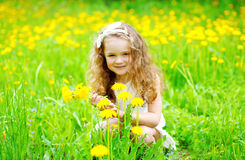 Portrait of little girl child outdoors on the grass Royalty Free Stock Photography
