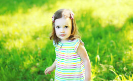 Portrait of little girl child walking in sunny summer Stock Photos